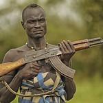 Helen Warnod - Mursi tribesman